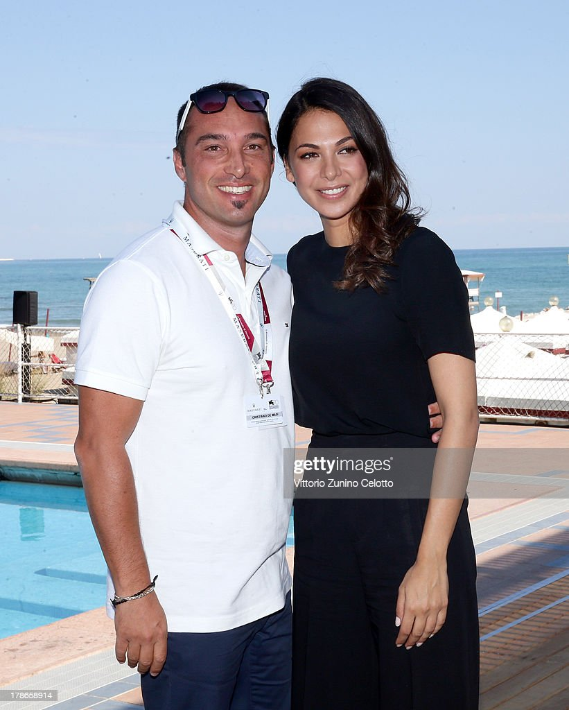Actress Moran Atias and producer Cristiano De Masi attend the 70th Venice International Film Festival at Terrazza Maserati on August 30, 2013 in Venice, Italy.