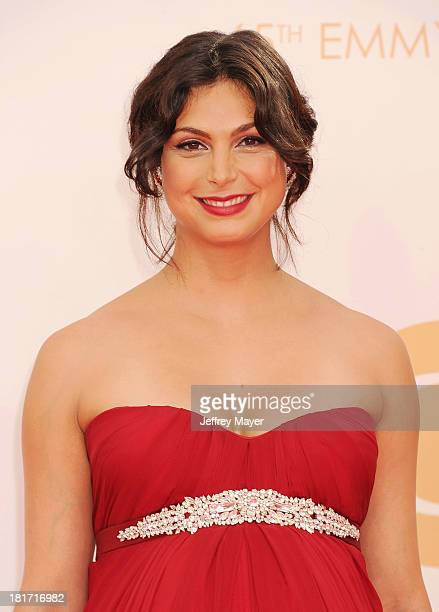 Actress Morena Baccarin arrives at the 65th Annual Primetime Emmy Awards at Nokia Theatre LA Live on September 22 2013 in Los Angeles California