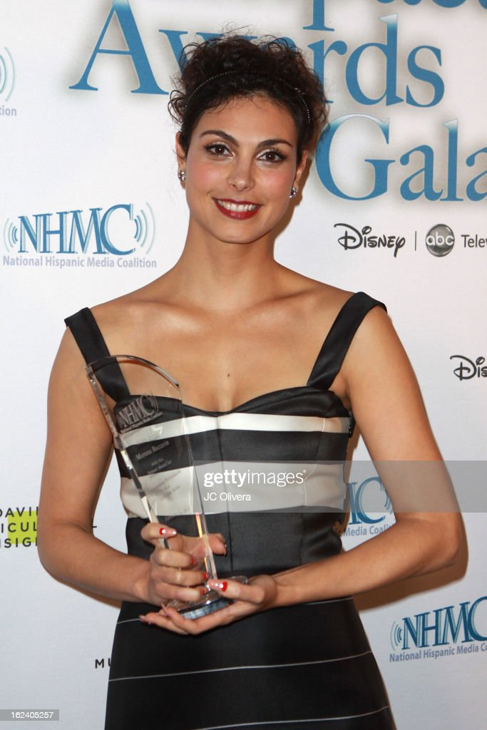 Actress Morena Baccarin poses with her Outstanding Performance in a Television Series Award during the National Hispanic Media Coalition's 16th Annual Impact Awards Gala at the Beverly Wilshire Four Seasons Hotel on February 22, 2013 in Beverly Hills, California.
