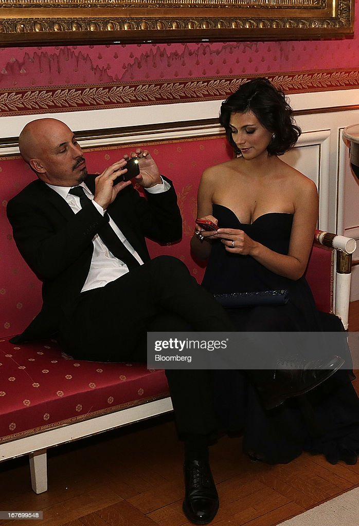Actress Morena Baccarin, right, and guest attend the Bloomberg Vanity Fair White House Correspondents' Association (WHCA) dinner afterparty in Washington, D.C., U.S., on Saturday, April 27, 2013. The 99th annual dinner raises money for WHCA scholarships and honors the recipients of the organization's journalism awards. Photographer: Scott Eells/Bloomberg via Getty Images