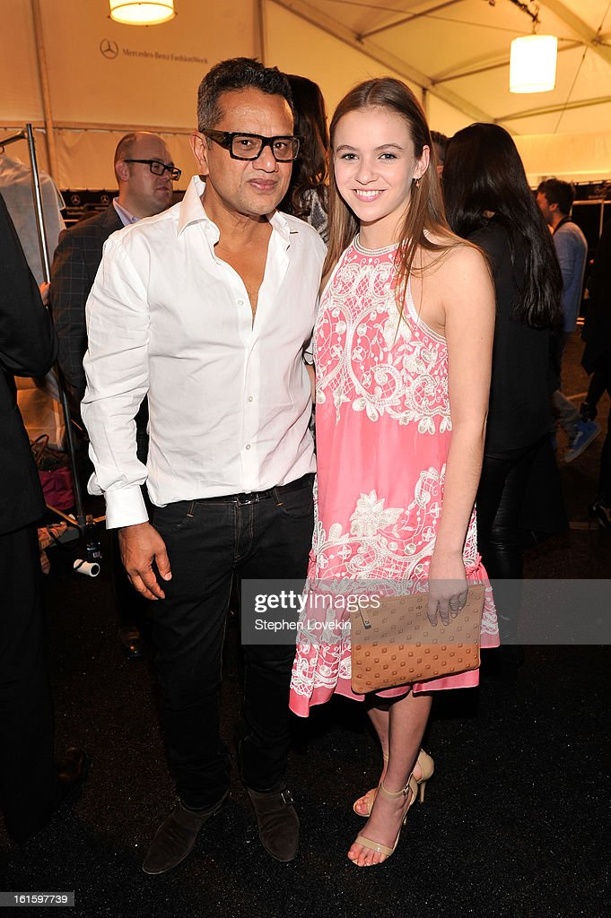 Actress <a gi-track='captionPersonalityLinkClicked' href=/galleries/search?phrase=Morgan+Saylor&family=editorial&specificpeople=8047326 ng-click='$event.stopPropagation()'>Morgan Saylor</a> poses with designer Naeem Khan backstage at the Naeem Khan Fall 2013 fashion show during Mercedes-Benz Fashion Week at The Theatre at Lincoln Center on February 12, 2013 in New York City.