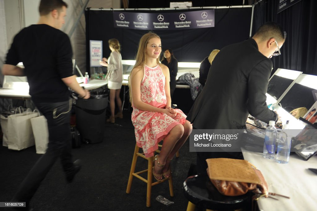 Actress <a gi-track='captionPersonalityLinkClicked' href=/galleries/search?phrase=Morgan+Saylor&family=editorial&specificpeople=8047326 ng-click='$event.stopPropagation()'>Morgan Saylor</a> prepares backstage at the Naeem Khan Fall 2013 fashion show during Mercedes-Benz Fashion Week at The Theatre at Lincoln Center on February 12, 2013 in New York City.
