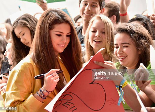 Actress multiplatinum recording artist and UNICEF Goodwill Ambassador Selena Gomez signs autographs at the WE Carpet at WE Day California 2016 at The...