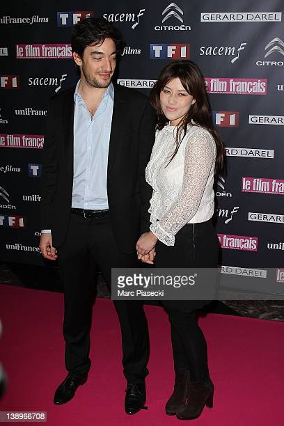 Actress Mylene Jampanoi and friend Dimitri attend the 'Trophees Du Film Francais 2012' photocall at Palais Brongniart on February 14 2012 in Paris...