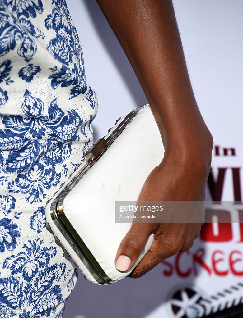 Actress Nadine Ellis clutch detail arrives at the Kids In The Spotlight's Movies By Kids For Kids Film Awards at Fox Studios on November 7 2015 in...