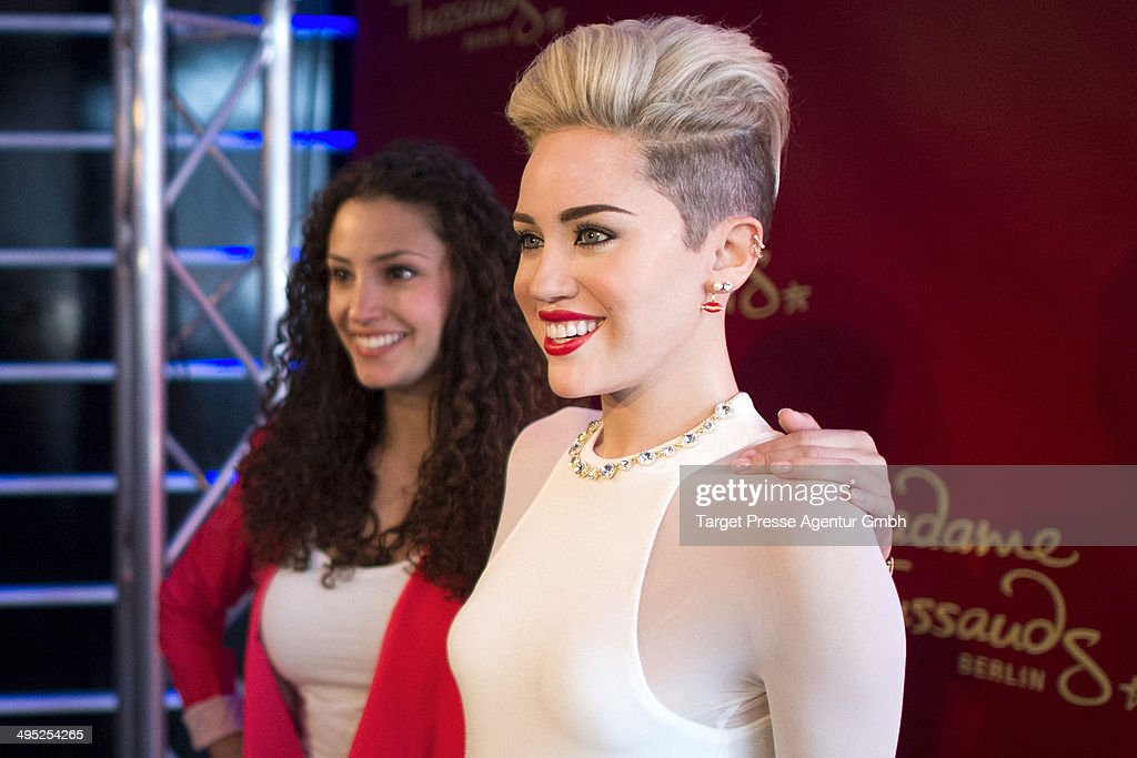 Actress Nadine Menz unveils a <a gi-track='captionPersonalityLinkClicked' href=/galleries/search?phrase=Miley+Cyrus&family=editorial&specificpeople=3973523 ng-click='$event.stopPropagation()'>Miley Cyrus</a> wax figure at Madame Tussauds on June 2, 2014 in Berlin, Germany.