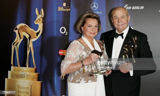 Actress Nadja Tiller and actor Walter Giller hold their Bambi Awards for Lifetime Achievement at the 58th annual Bambi Awards at the MercedsBenz...