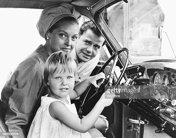 Actress Nadja Tiller at the wheel of a car with her daughter Natascha as her husband Walter Giller looks on during their vacation at the Lido in...