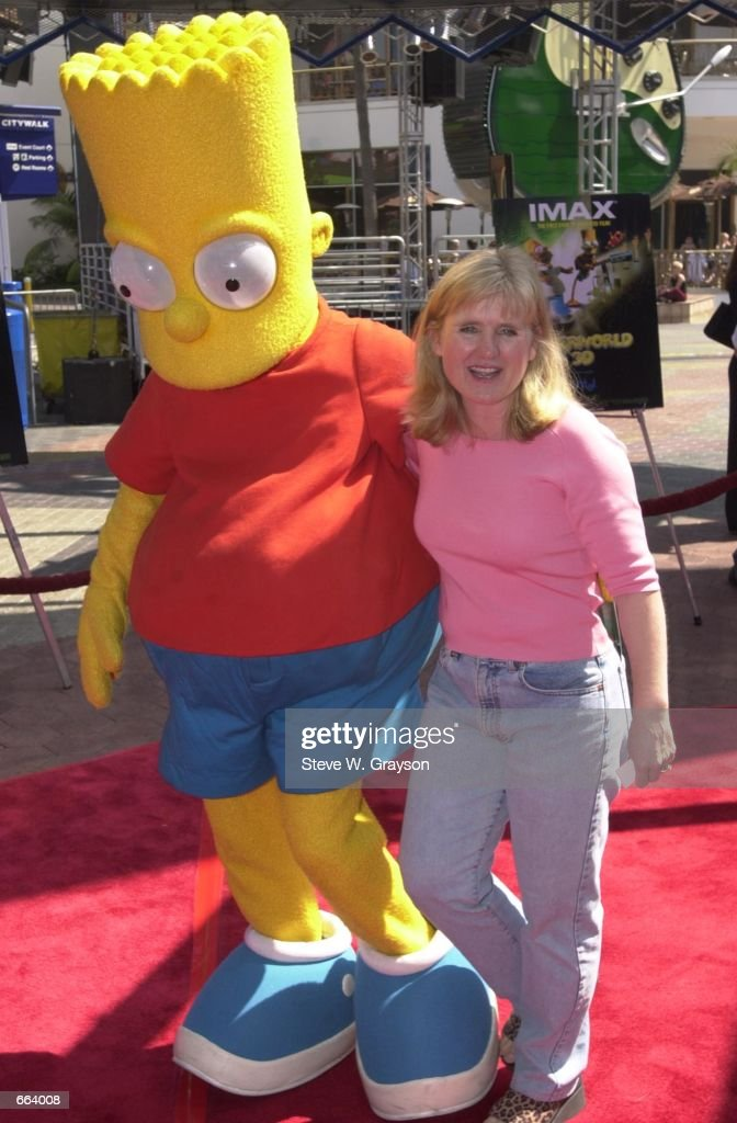 Actress Nancy Cartwright the voice of the animated Bart Simpons poses with a lifesize Bart October 1 2000 at the premiere of Cyberworld 3D at the...