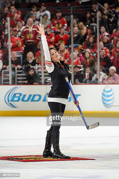 Actress Nancy Lee Grahn reacts after making her shot in between periods of the NHL game between the Dallas Stars and the Chicago Blackhawks at the...