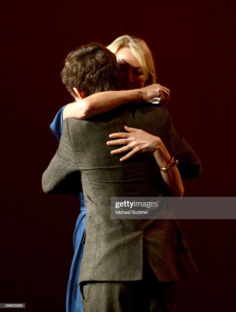 Actress Naomi Watts accepts the Desert Palm Achievement Award - Actress from actor Tom Holland onstage during the 24th annual Palm Springs International Film Festival Awards Gala at the Palm Springs Convention Center on January 5, 2013 in Palm Springs, California.