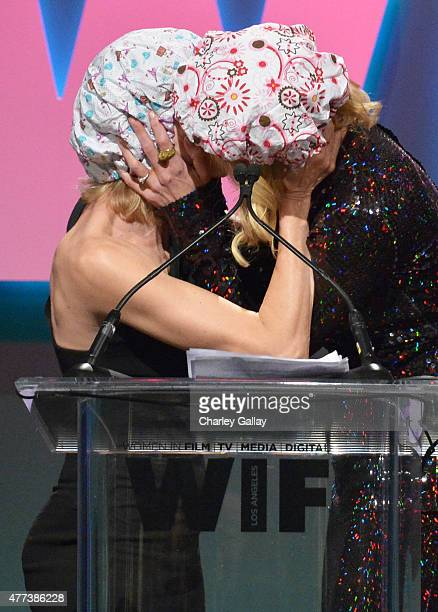 Actress Naomi Watts and honoree Nicole Kidman recipient of The Crystal Award for Excellence in Film kiss onstage during the Women In Film 2015...