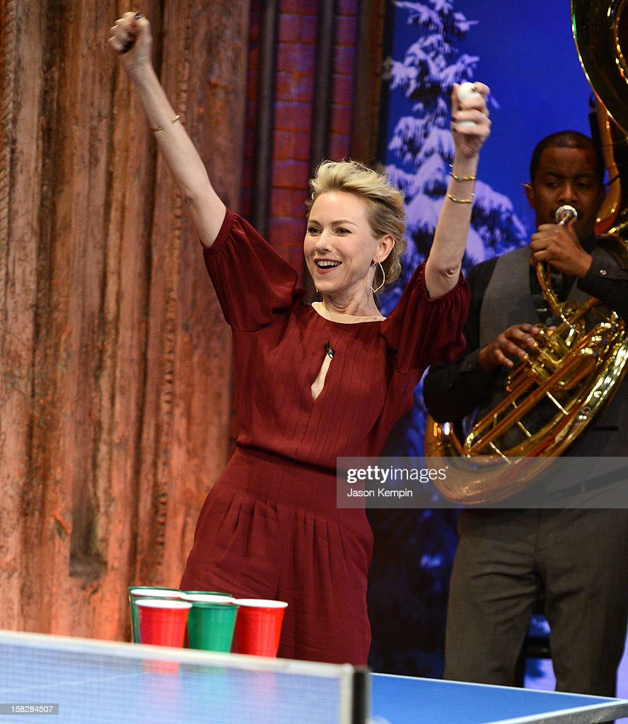 Actress Naomi Watts plays beer pong during 'Late Night With Jimmy Fallon' at Rockefeller Center on December 12, 2012 in New York City.
