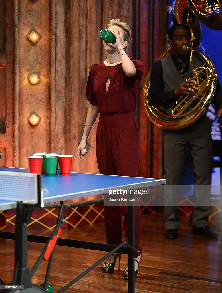 Actress <a gi-track='captionPersonalityLinkClicked' href=/galleries/search?phrase=Naomi+Watts&family=editorial&specificpeople=171723 ng-click='$event.stopPropagation()'>Naomi Watts</a> plays beer pong during 'Late Night With Jimmy Fallon' at Rockefeller Center on December 12, 2012 in New York City.