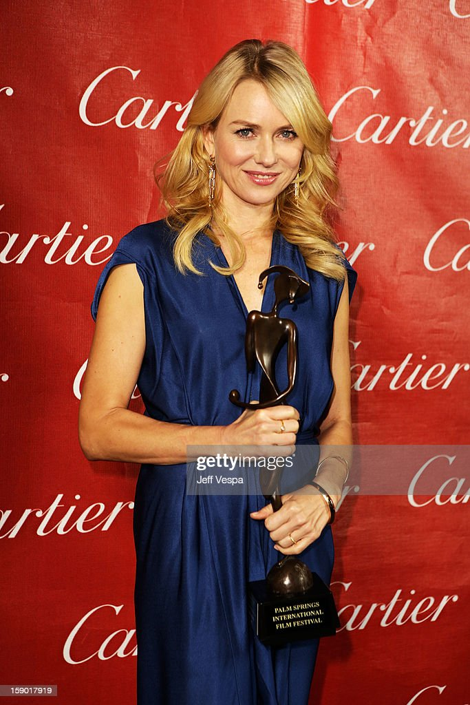 Actress Naomi Watts poses with the Desert Palm Achievement Award - Actress at the 24th annual Palm Springs International Film Festival Awards Gala at the Palm Springs Convention Center on January 5, 2013 in Palm Springs, California.