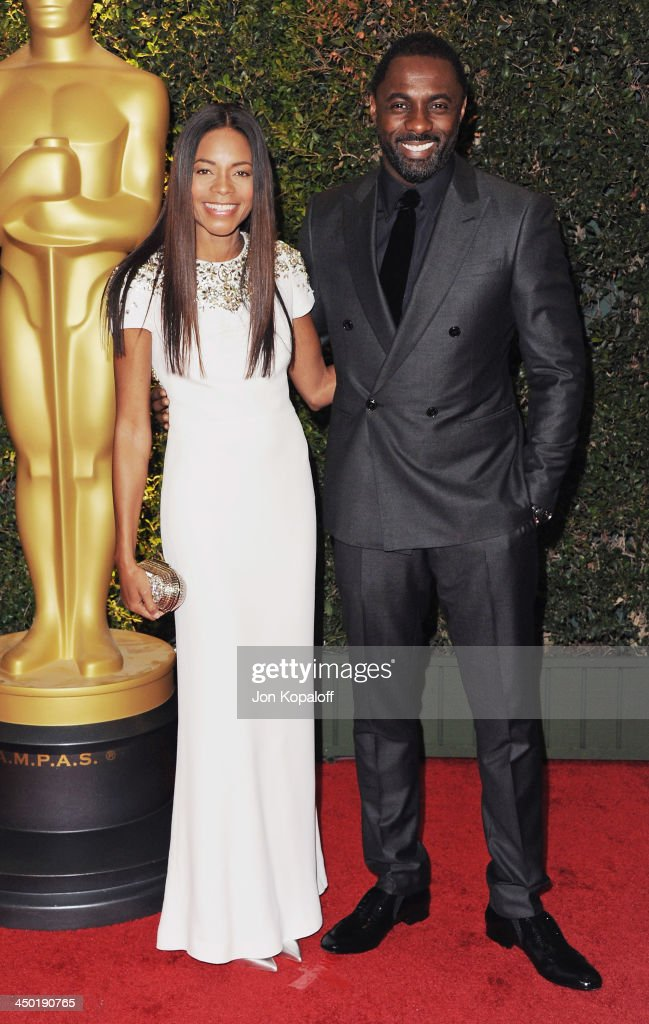 Actress <a gi-track='captionPersonalityLinkClicked' href=/galleries/search?phrase=Naomie+Harris&family=editorial&specificpeople=238918 ng-click='$event.stopPropagation()'>Naomie Harris</a> and actor <a gi-track='captionPersonalityLinkClicked' href=/galleries/search?phrase=Idris+Elba&family=editorial&specificpeople=215443 ng-click='$event.stopPropagation()'>Idris Elba</a> arrive at The Board Of Governors Of The Academy Of Motion Picture Arts And Sciences' Governor Awards at Dolby Theatre on November 16, 2013 in Hollywood, California.