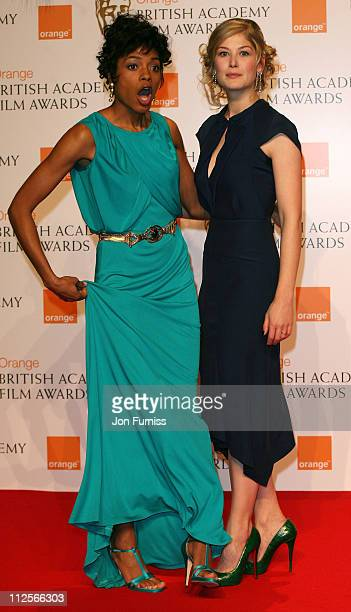Actress Naomie Harris and Rosamund Pike pose in the Press Room during The Orange British Academy Film Awards 2008 at The Royal Opera House Covent...