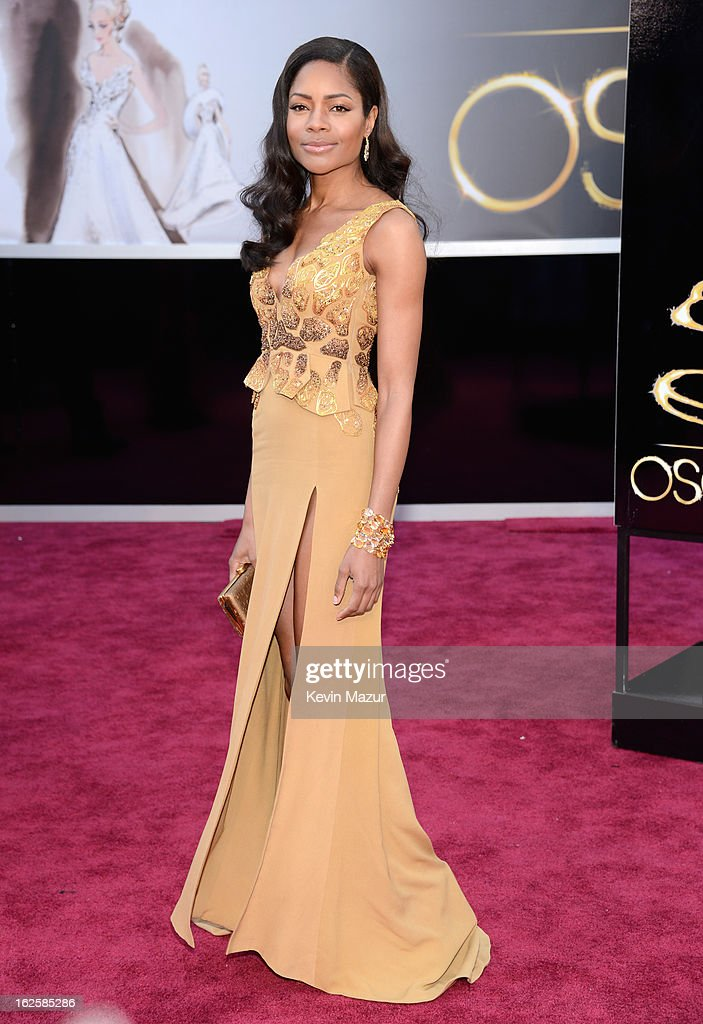Actress <a gi-track='captionPersonalityLinkClicked' href=/galleries/search?phrase=Naomie+Harris&family=editorial&specificpeople=238918 ng-click='$event.stopPropagation()'>Naomie Harris</a> arrives at the Oscars held at Hollywood & Highland Center on February 24, 2013 in Hollywood, California.