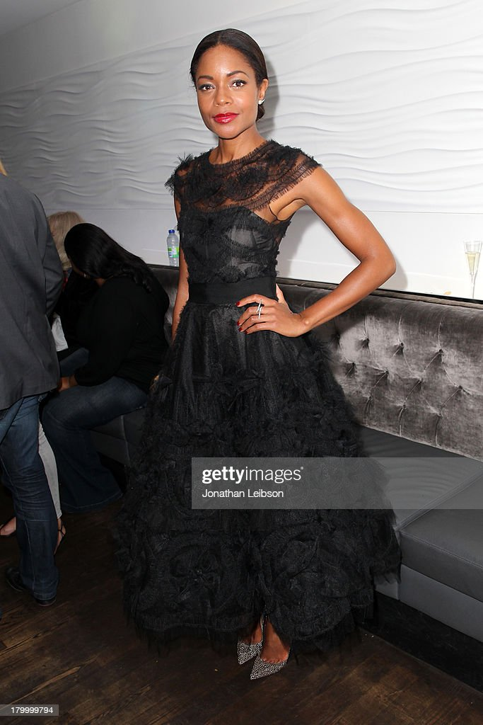Actress <a gi-track='captionPersonalityLinkClicked' href=/galleries/search?phrase=Naomie+Harris&family=editorial&specificpeople=238918 ng-click='$event.stopPropagation()'>Naomie Harris</a> attends the Burberry supported premiere and celebration of 'Mandela: Long Walk to Freedom' hosted by The Weinstein Company and Entertainment One at the Toronto International Film Festival on September 7, 2013 in Toronto, Canada.