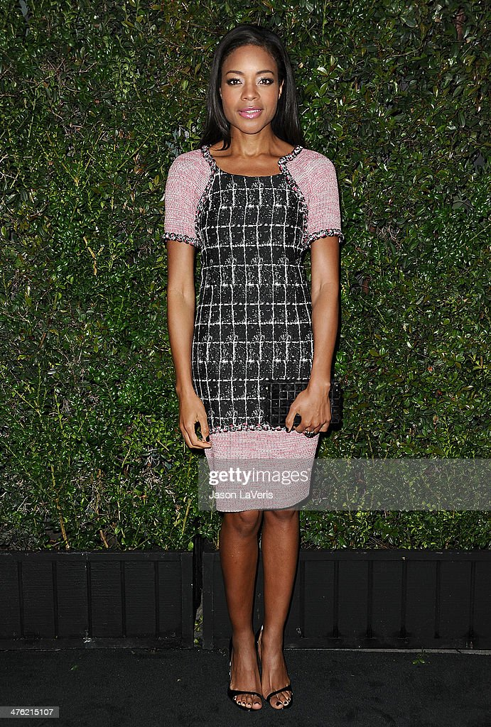 Actress Naomie Harris attends the Chanel and Charles Finch pre-Oscar dinner at Madeo Restaurant on March 1, 2014 in Los Angeles, California.