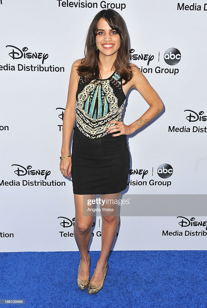 Actress <a gi-track='captionPersonalityLinkClicked' href=/galleries/search?phrase=Natalie+Morales+-+Actress&family=editorial&specificpeople=15326754 ng-click='$event.stopPropagation()'>Natalie Morales</a> arrives at the Disney Media Networks International Upfronts at Walt Disney Studios on May 19, 2013 in Burbank, California.