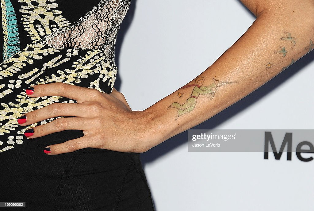Actress Natalie Morales (nail and tattoo detail) attends the Disney Media Networks International Upfronts at Walt Disney Studios on May 19, 2013 in Burbank, California.