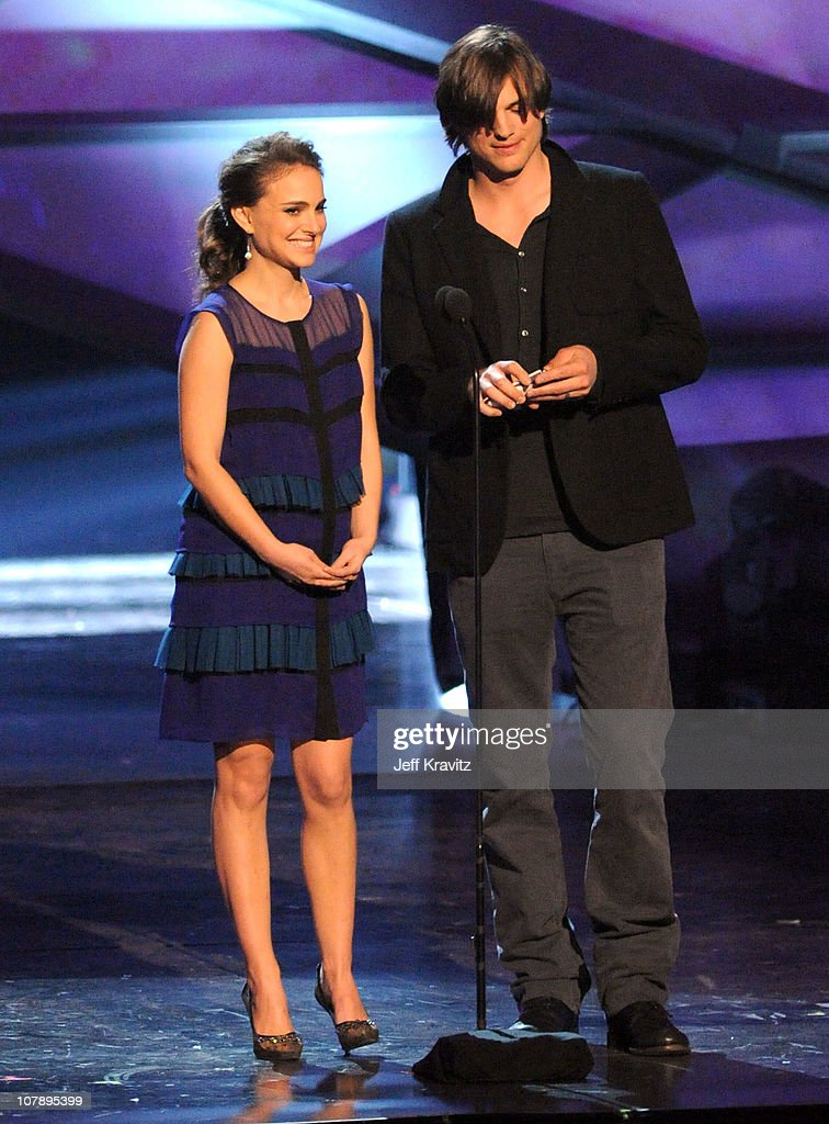 Actress <a gi-track='captionPersonalityLinkClicked' href=/galleries/search?phrase=Natalie+Portman&family=editorial&specificpeople=202035 ng-click='$event.stopPropagation()'>Natalie Portman</a> (L) and <a gi-track='captionPersonalityLinkClicked' href=/galleries/search?phrase=Ashton+Kutcher&family=editorial&specificpeople=202015 ng-click='$event.stopPropagation()'>Ashton Kutcher</a> speak onstage during the 2011 People's Choice Awards at Nokia Theatre L.A. Live on January 5, 2011 in Los Angeles, California.