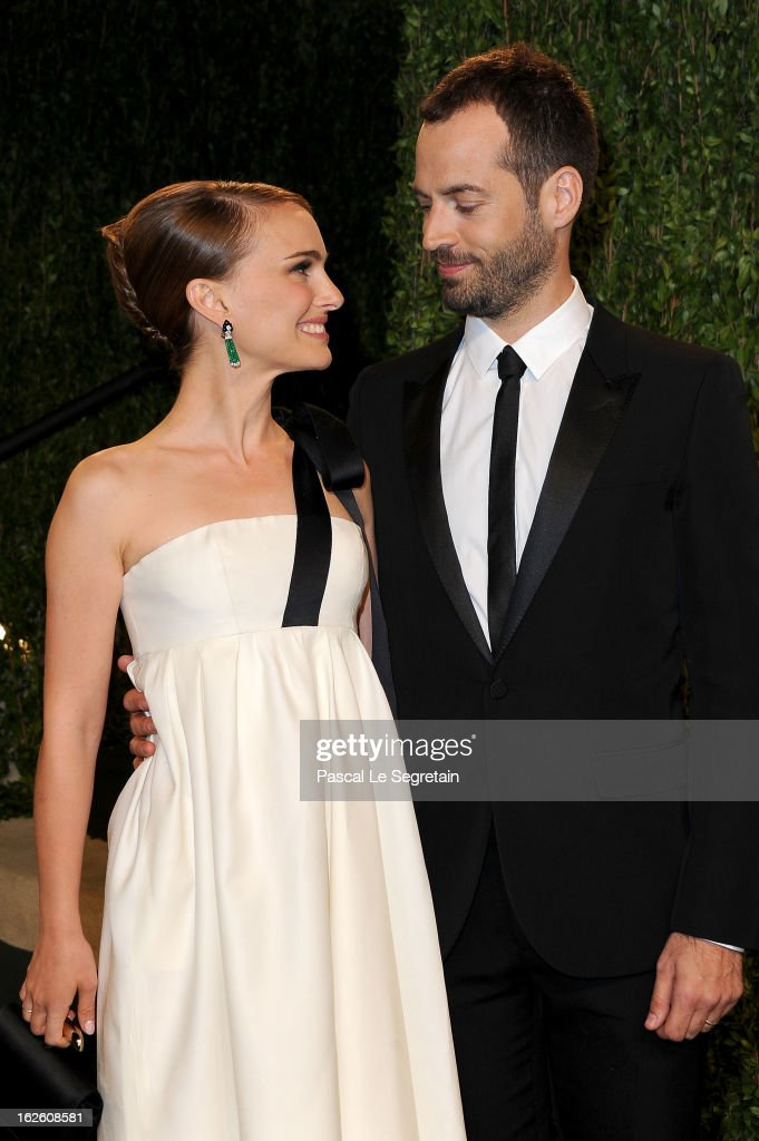 Actress <a gi-track='captionPersonalityLinkClicked' href=/galleries/search?phrase=Natalie+Portman&family=editorial&specificpeople=202035 ng-click='$event.stopPropagation()'>Natalie Portman</a> (L) and choreographer <a gi-track='captionPersonalityLinkClicked' href=/galleries/search?phrase=Benjamin+Millepied&family=editorial&specificpeople=6539957 ng-click='$event.stopPropagation()'>Benjamin Millepied</a> arrive at the 2013 Vanity Fair Oscar Party hosted by Graydon Carter at Sunset Tower on February 24, 2013 in West Hollywood, California.