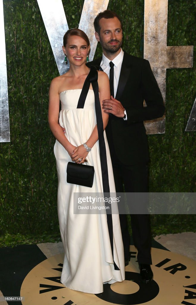 Actress Natalie Portman (L) and husband Benjamin Millepied attend the 2013 Vanity Fair Oscar Party at the Sunset Tower Hotel on February 24, 2013 in West Hollywood, California.