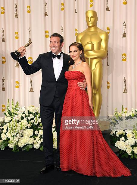 Actress Natalie Portman poses with Jean Dujardin winner of the Best Actor Award for 'The Artist' in the press room at the 84th Annual Academy Awards...