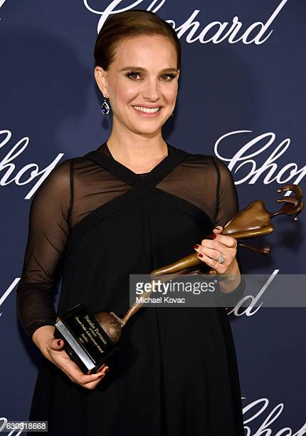 Actress Natalie Portman poses with the Desert Palm Achievement Award during the 28th Annual Palm Springs International Film Festival Film Awards Gala...