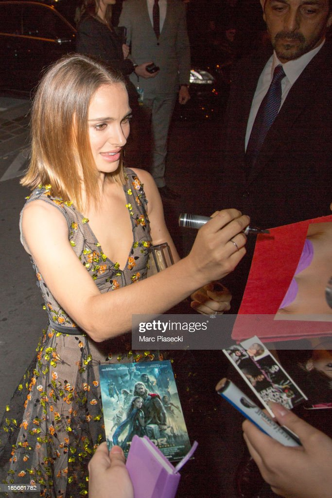 Actress Natalie Portman signs autographs as she attends the 'Thor: The Dark World' Paris premiere at Le Grand Rex on October 23, 2013 in Paris, France.