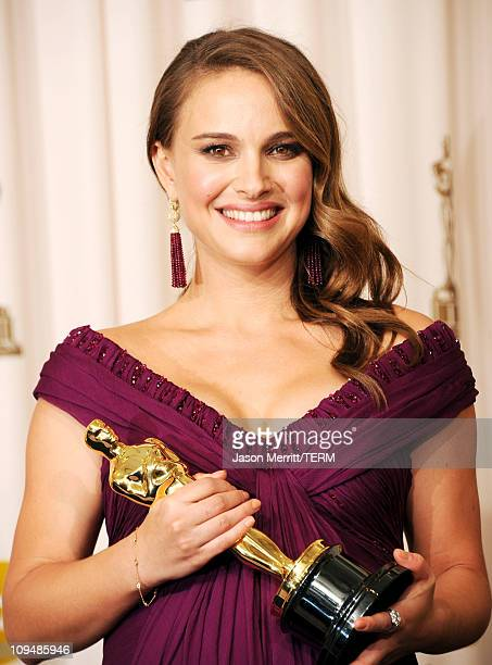 Actress Natalie Portman winner of the award for Best Actress in a Leading Role for 'Black Swan' poses in the press room during the 83rd Annual...