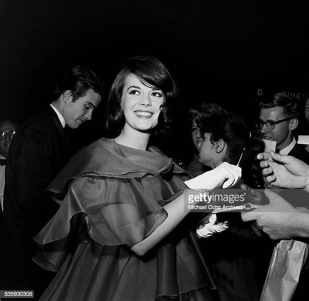 Actress Natalie Wood and actor Warren Beatty signs autographs for fans during the premiere of 'Splendor in the Grass' in Los AngelesCA