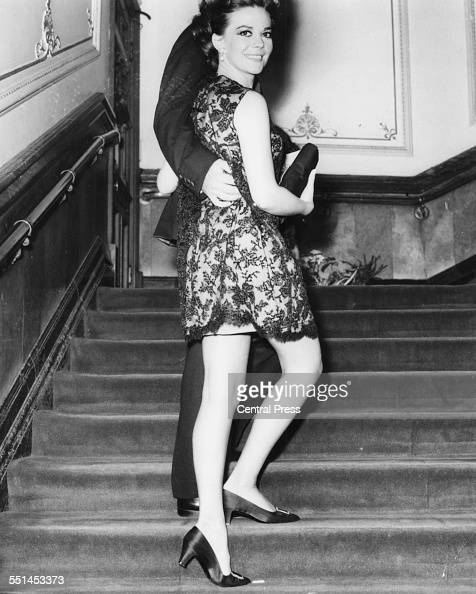 Actress Natalie Wood and guest walking up a staircase at the premiere of the film 'The Bible In The Beginning' London October 7th 1966