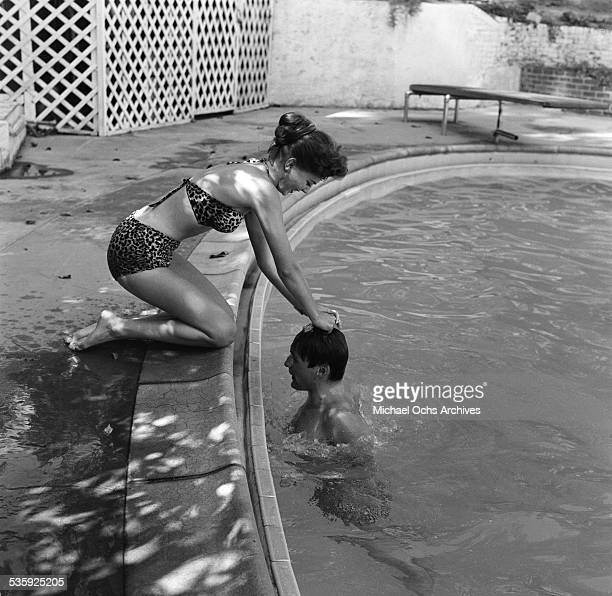 Actress Natalie Wood has a pool party in Los AngelesCA