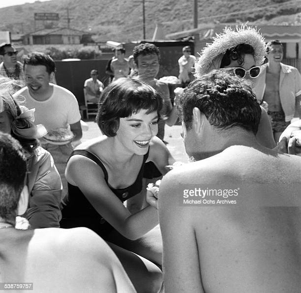 Actress Natalie Wood plays during the Thalians Beach Ball in MalibuCalifornia