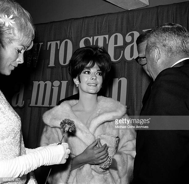 Actress Natalie Wood poses as she attends the premiere of 'How to Steal a Million' in Los AngelesCA