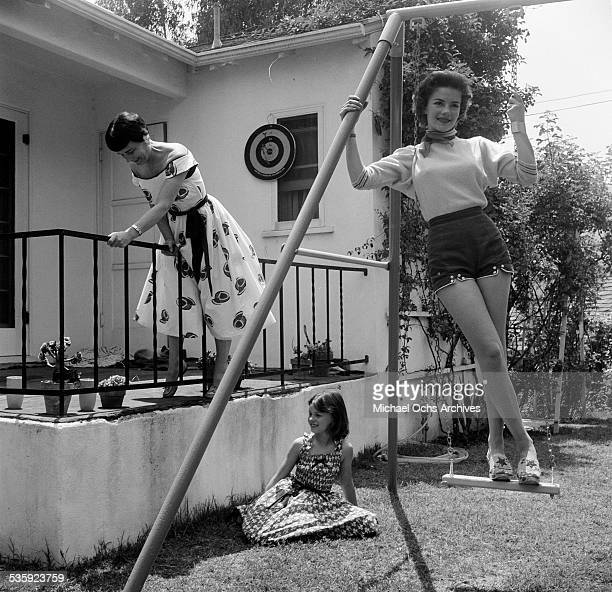 Actress Natalie Wood poses for a portrait with her mother and sister Lana at home in Los AngelesCA