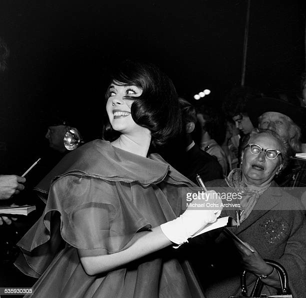 Actress Natalie Wood signs her autographs for fans during the premiere of 'Splendor in the Grass' in Los AngelesCA