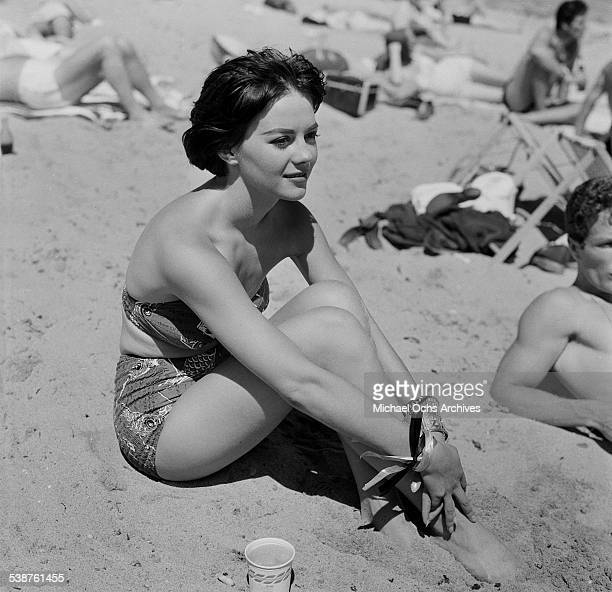 Actress Natalie Wood sits on the beach during the Thalians Beach Ball in MalibuCalifornia