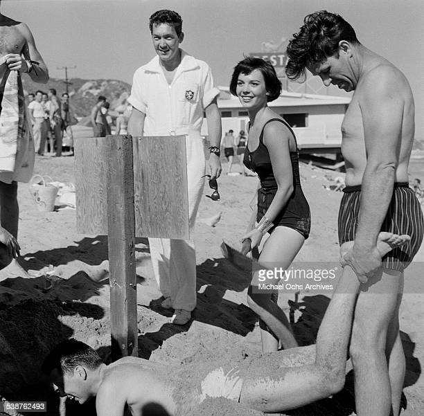 Actress Natalie Wood stands with a shovel during the Thalians Beach Ball in MalibuCalifornia