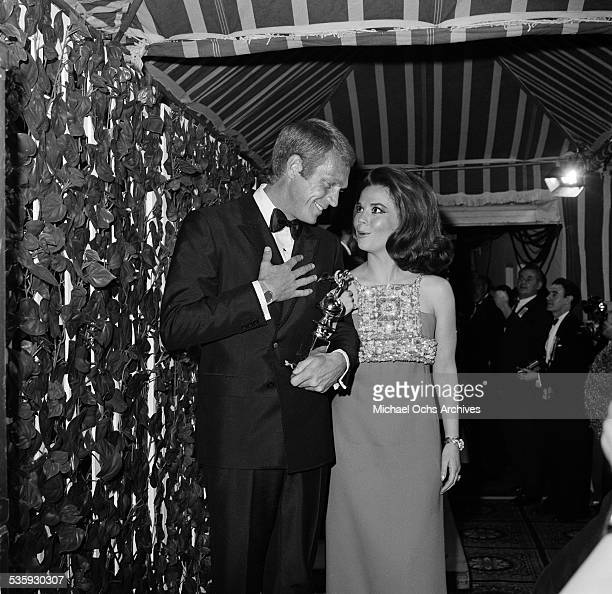 Actress Natalie Wood walks with actor Steve McQueen after she won Best Actress Drama Series for ' From Here to Eternity' at the 37th Golden Globe...