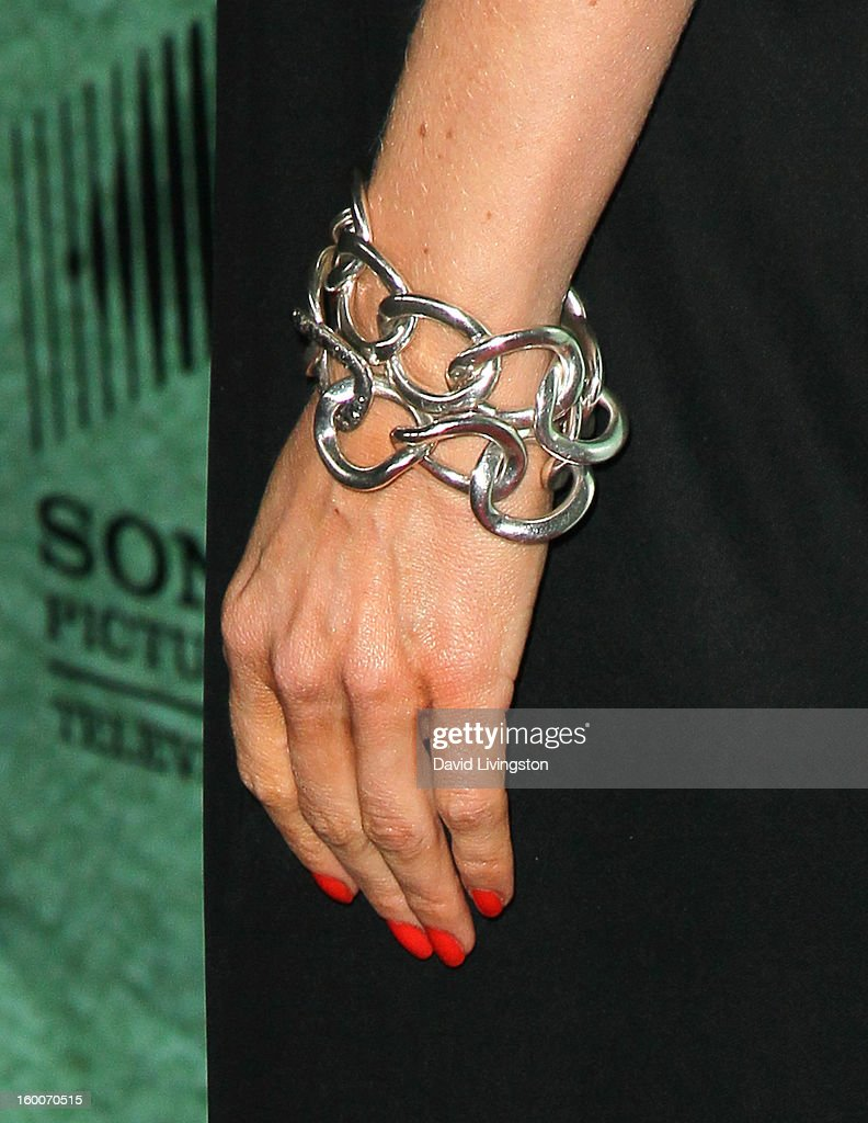 Actress Natalie Zea (bracelet detail) attends the premiere of FX's 'Justified' Season 4 at the Paramount Theater on the Paramount Studios lot on January 5, 2013 in Hollywood, California.