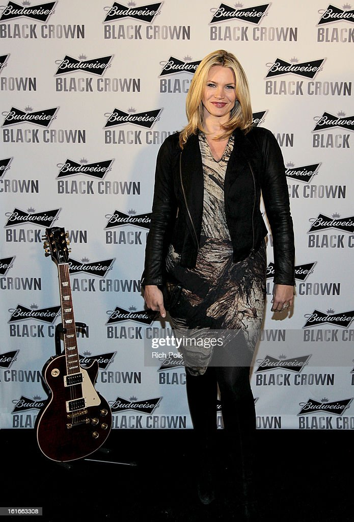 Actress <a gi-track='captionPersonalityLinkClicked' href=/galleries/search?phrase=Natasha+Henstridge&family=editorial&specificpeople=209364 ng-click='$event.stopPropagation()'>Natasha Henstridge</a> attends the Budweiser Black Crown Launch Party at gibson/baldwin showroom on February 13, 2013 in Los Angeles, California.