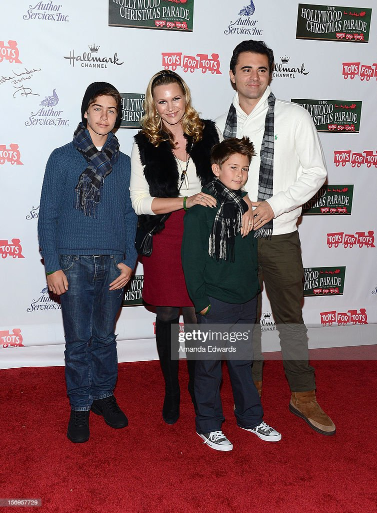 Actress Natasha Henstridge (C), singer Darius Campbell (R) and sons arrive at the 2012 Hollywood Christmas Parade Benefiting Marine Toys For Tots on November 25, 2012 in Hollywood, California.