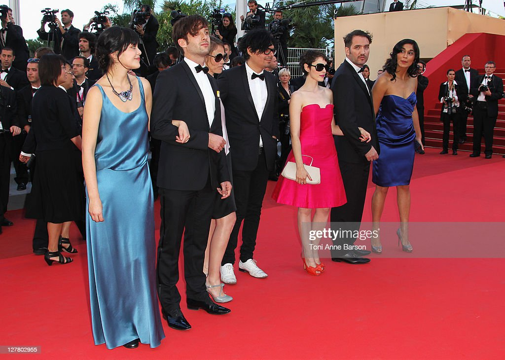 Actress Nathalia Galgani (L) actor Diego Noguera (second left) director Cristian Jimenez (second right) and actress Gabriela Arancibia (R) and guests from the film 'Bonsai' attend 'The Artist' Premiere at the Palais des Festivals during the 64th Cannes Film Festival on May 15, 2011 in Cannes, France.