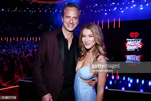Actress Nathalia Ramos and iHeartMedia's President of National Programming Platforms Tom Poleman attend the iHeartRadio Music Awards at The Forum on...