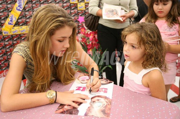Actress Nathalia Ramos at an autograph signing event with the cast