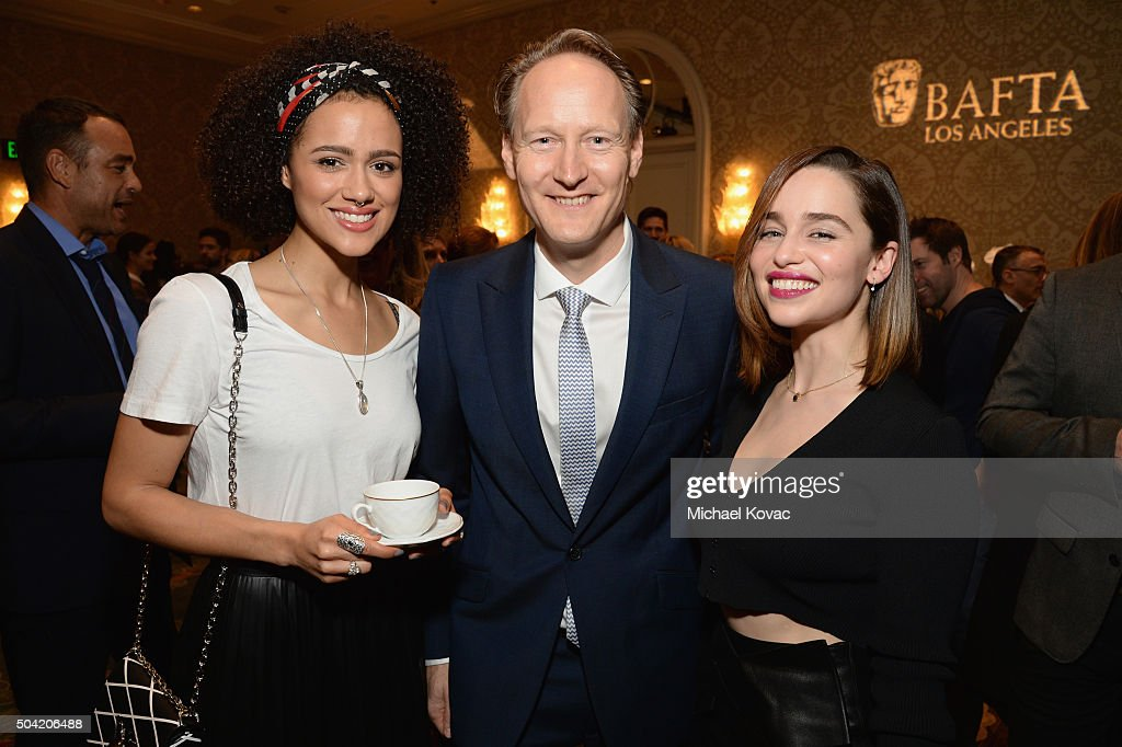 Actress Nathalie Emmanuel, British Consul General in Los Angeles Chris O'Connor, and actress Emilia Clarke attend the BAFTA Los Angeles Awards Season Tea at Four Seasons Hotel Los Angeles at Beverly Hills on January 9, 2016 in Los Angeles, California.